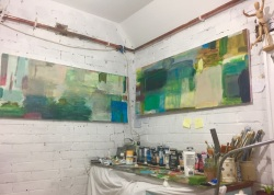 Two paintings , Bright Sky Streaming and I wish I had a River by the palette